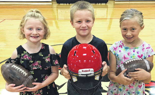 The Cardington-Lincoln 2019 junior homecoming court, from left: first grade students Cecilia Goers, Blake Goble and Ellee Hansen.