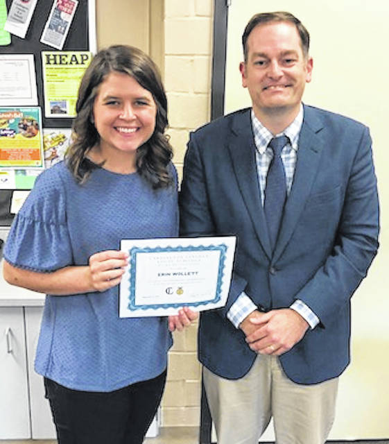 Cardington-Lincoln Schools Superintendent Brian Petrie presents a certificate of Appreciation to VoAg teacher Erin Wollett, in recognition of her award as Outstanding Early Career Educator of the Year by the OAAE. The presentation was made during the Sept. 9 board of education meeting.