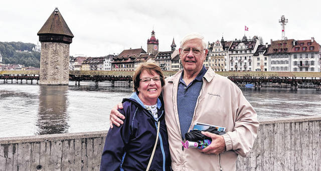 Allen and Alberta Stojkovic on an overcast day in Lucerne, Switzerland, by the Kappelle Brucke (Chapel Bridge.) The bridge was built in 1333.