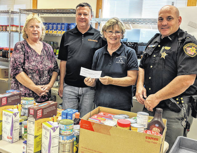 Kokosing Industrial contributes to the Morrow County Food Pantry. From left: Food Pantry Director Teresa Shipman, Kokosing Project Manager Jason Ballard, Food Pantry Director Brenda Harden and Food Pantry board member Sheriff John Hinton.