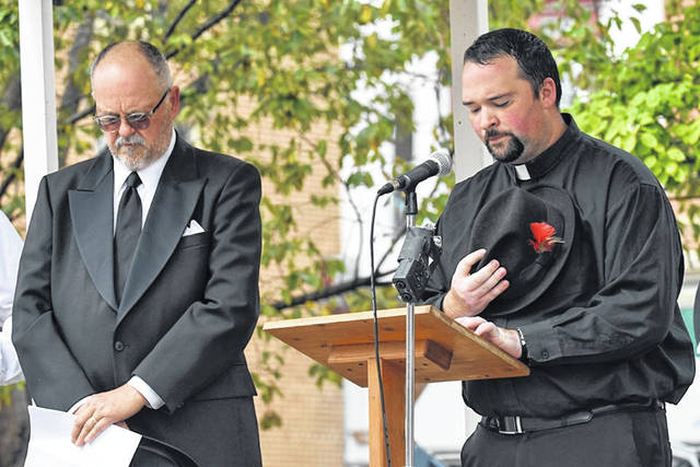 Morrow Little Theatre members took part in the Victory Shaft re-enactment Saturday in downtown Mount Gilead. This was the invocation delivered by Jamie Brucker, right, as Rev. D.H. Cramer.