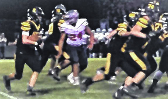 Wyatt Reeder runs for yardage in the fourth quarter of Northmor's 27-21 win over Centerburg Friday night.