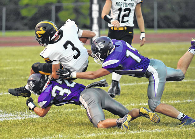 Northmor running back Wyatt Reeder is brought down by Mount Gilead defenders Matt Bland and Jacob Simmons Friday night. The Knights won 47-13 as Reeder ran for 3 touchdowns and 188 yards.