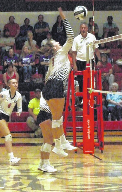 Cardington's Hannah Wickline goes up for a kill attempt against Mount Gilead on Tuesday.