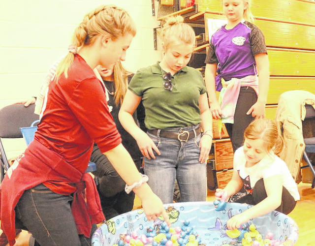 Haleigh Roles, Amy Caldwel, Ashtyn Gal and Marley Mandeville enjoy a game at the fall festival.