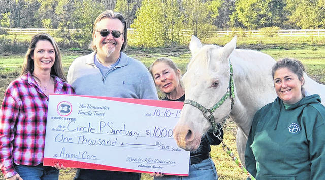 Shown, from left: Krista Bonecutter, Rockwell Bonecutter, Lynne Petitti, Dusty, the 27-year-old horse who sparked the cause, and Jennifer Petitti.
