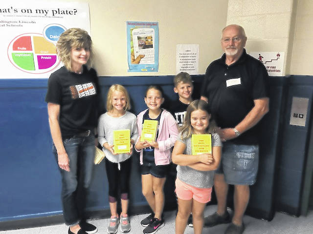 Several Cardington-Lincoln third grade students with their new dictionaries presented by the Cardington Rotary Club. From left: Janet Sedlacek, third grade teacher; Mickenzie White, Annabelle Lackey, Kaiden Reed, students Gilbert Ullom, Cardington Rotary treasurer who presented the dictionaries. In front is student Josie Hough.