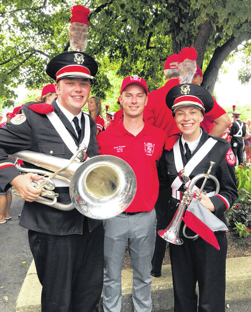 Mount Gilead graduates Noah Tuggle (l) and Mallory Cooper (r) stand with Mount Gilead band director Ross Runyan during Ohio State Alumni Band weekend on Saturday, Aug. 31, when the university's football team played Florida Atlantic. Cooper is a third-year member of TBDBTL, while Cooper is a first-year member and Runyan is a TBDBTL alumni. The picture was taken outside St. John Arena after the skull session.
