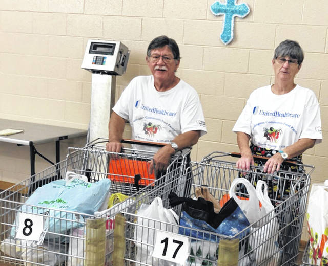 Larry Smith and Diane Van Houten with food collected at First United Methodist Church, Cardington.