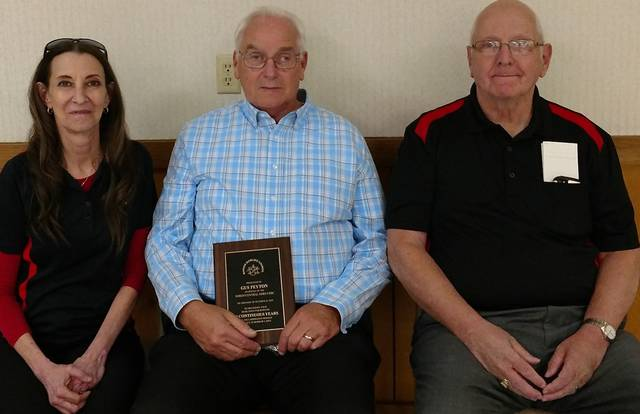 Seated: Gus Peyton, center, who received the 50-year award. He is flanked by Lisa Caudill, president of the North Central Ohio USBC, and Ivan Lanius, association manger of the NCO USBC.