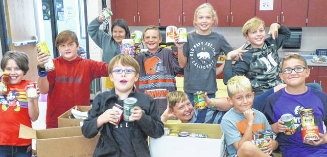 Pictured is the Park Avenue Elementary School fifth grade Art Club who joined with Chester Arbor of the Gleaners Insurance, to hold a canned food drive Sept. 27 at the school. Students brought in 657 cans which were donated to the Trinity Food Pantry. Mrs. Martin's fourth grade class brought in 168 cans, the most of any class, winning them a pizza party. Pictured is the Park Avenue Elementary fifth grade Art Club, from left, back row: Back row: Emma Lockhart, Jayden Fisher, Lluvia Nunviller, Brody Sergent, Sophie Mosher, Hawke Littell, Nate Meier. Front row: Hunter Evans, Wyatt Long and Gavin Spoon.