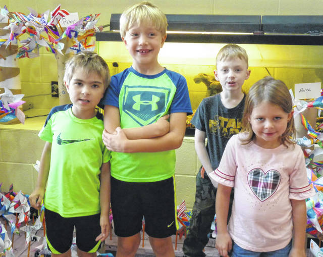 These students made Pinwheels for Peace and are seen standing in the garden of Pinwheels for Peace at the Park Avenue School in Mount Gilead are, from left: David Quillan, Ben Griffith, Nicholas Ramsey and Madison Fitzpatrick.