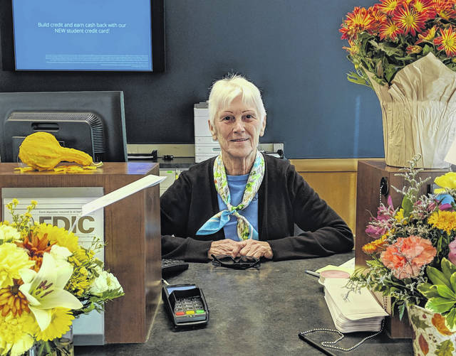 Karen Varner is surrounded by flowers on her last day at Chase Bank in Mount Gilead. It was her last day after 43 years with the bank.