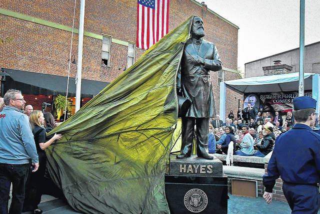 The city of Delaware celebrated the birthday of its most famous son, Rutherford B. Hayes, with the unveiling of a bronze statue in his likeness on the southwest corner of Sandusky and William streets Friday evening.