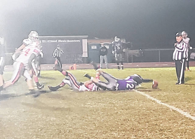 Brady Mermann stretches across the goal line for six points in his Mount Gilead team's 34-6 win over visiting Fredericktown.