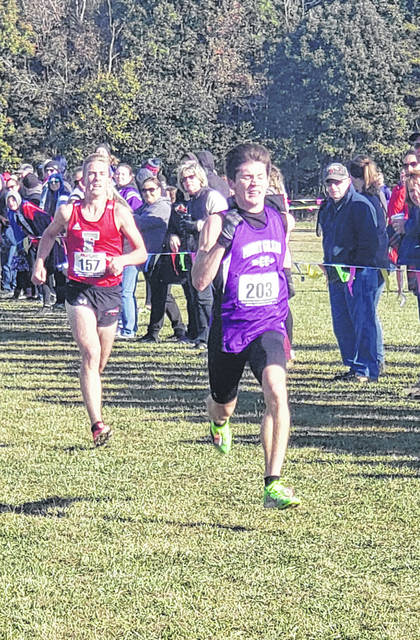 Liam Dennis was the individual championship in the KMAC boys' cross country race, while his Mount Gilead team also won the team title.