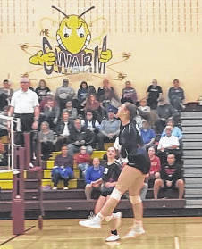 Makenna Belcher hits the ball in her Highland team's three-set win over London in the Division II district semifinals.