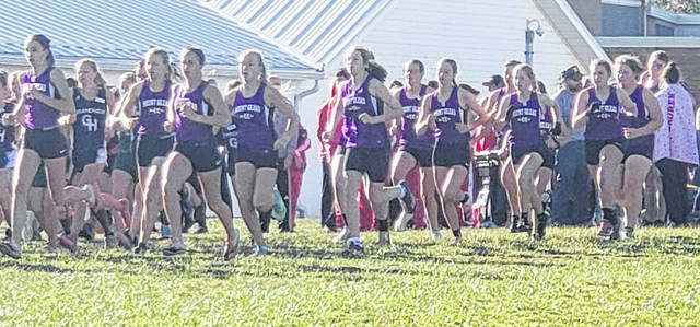 Members of the Mount Gilead girls' cross country team start their race Saturday when they hosted the school's Thill Invitational.