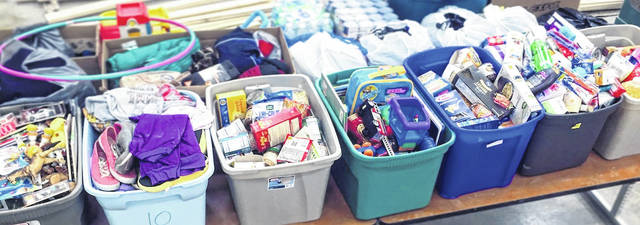 Highland FFA donates 20 overflowing totes to local food pantry.