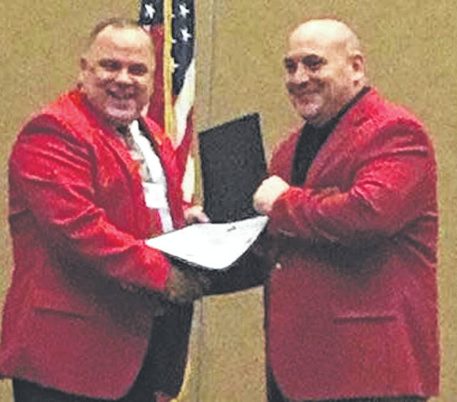 Morrow County Sheriff John Hinton received the Buckeye State Sheriff's Association's Certified Law Enforcement Manager Award at the annual awards brunch Nov. 20. This honor is awarded to those sheriffs and command staff who over the past year have attended classes and trainings that further the professional goals and values of the Sheriff's Office and have met at least the minimum number of hours required for this distinguished award. Presenting the award is Muskingum County Sheriff Matt Lutz, who is President of the Buckeye State Sheriff's Association.
