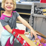 Students fill shoeboxes to send abroad
