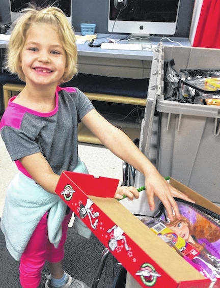Charlotte Van Hoose prepares a shoe box for the Operation Christmas Child. She is a first-grade student at Cardington-Lincoln