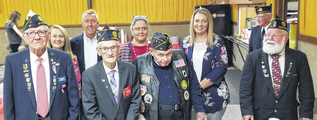 Courtesy Photo | Brenda Harden  Members of Post 97 at the Veterans Day Dinner at Cardington are front row, from left: Jim Crawford, Post 97 Commander, Jim Morris, first vice commander; Fred Barber and Bart Arndt both Post 97 members. Back row: Beth Hewes, Thomas Wyett, Traci Burn and Christin McGrawwith the caterers and Bruce Fissell, right Post 97 member.