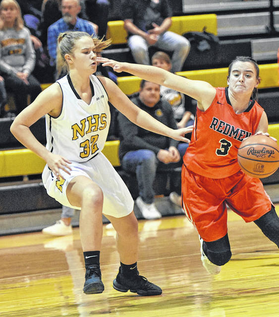 Northmor's Lexi Wenger, shown playing defense against Bucyrus Saturday, led her team in scoring in both games the Golden Knights competed in during the weekend.