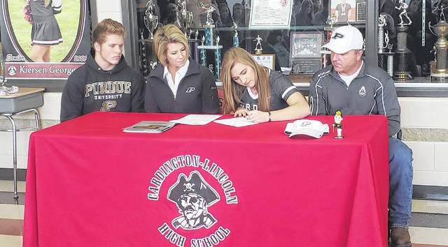 Cardington senior Kierson George signs her letter of intent to play softball for Purdue University. Sitting with George are (l-r) her brother, Garrett, her mother, Jessica, and her father, Cecil.