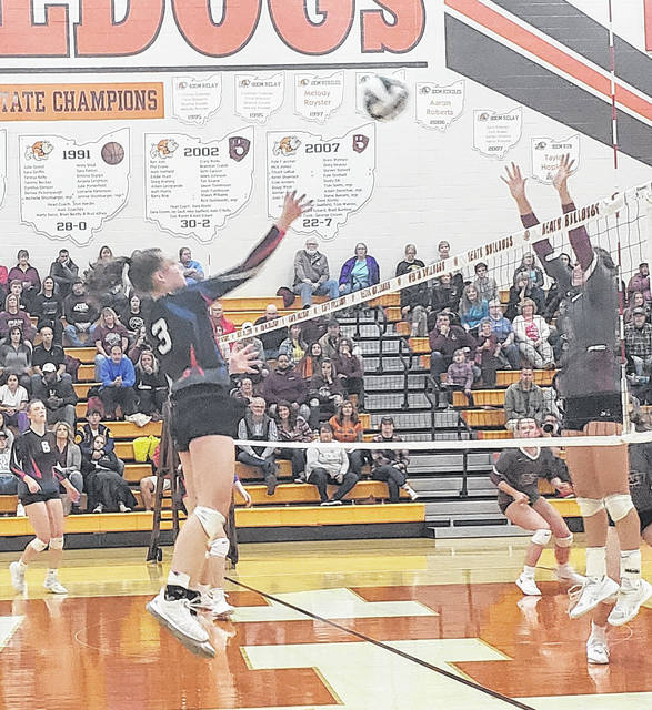 Highland's Kendall Stover hits the ball over the net in her team's come-from-behind five-set win over New Concord John Glenn that advanced them to the regional finals.