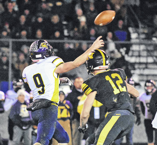 Blake Miller rushes the Hillsdale quarterback in Northmor's Division VI playoff game Friday night. Miller also hauled in three touchdown passes to make an impact on both sides of the ball.