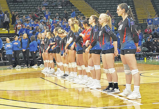 Highland's volleyball team waits for the beginning of their Division II state semifinal match against Parma Heights Holy Name on Thursday.