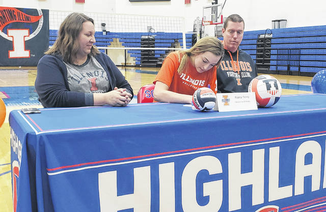 Highland senior Raina Terry signs to play volleyball for the University of Illinois. Flanking her are her parents, Jaime (l) and Nick.