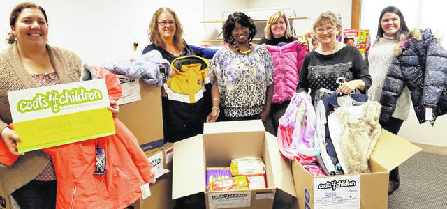 Courtesy Photo From left: Jamie Zeger, Amy Craig, Director of Coats for Children Beverly Robinson, Lori Smith, Brenda Harden and Cheyenne Downey.