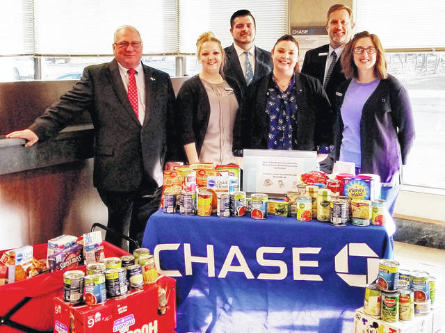 Chase Bank supports Food Pantry with a holiday food drive at the Mount Gilead branch. The food drive started in November and was given to the local pantries so it could be passed out to Morrow County families for the holidays. From left to right: The Mount Gilead Chase team of Ed Schillig, Haley Johnson, Josh Jackson, April Wrobel, Jason Brooke and Jordan Cremeans.