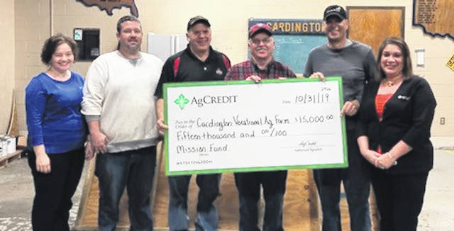 AgCredit presents a check to Cardington Vocational Agriculture Farm Association. Shown, from left; Andrea Bayles, AgCredit; Nathan Mosher, Doug Heacock, Gary Fiant, Matthew Clinger and Neeta Shuff, AgCredit.