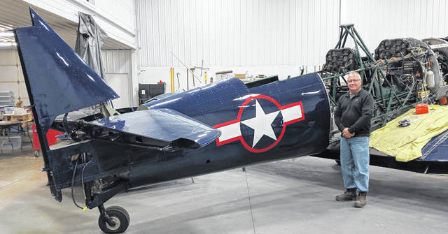 Alan Hughes completed work painting the AT-6 airplane that was used for training pilots in World War II. The star and bars are one of the Army Air Corps insignia from World War II. Zach Haskins is working to restore the engine on the aircraft.