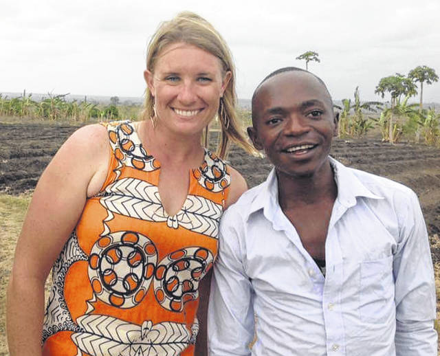 Liz Gliem with team leader Mario at tree farm in Mieze, Africa.