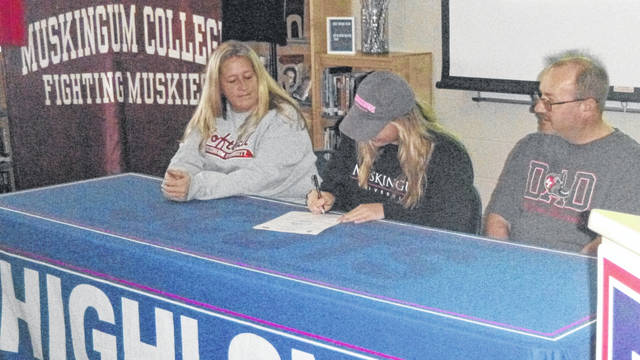 Mattie Ruehrmund has signed to attend and play softball at Muskingum University in New Concord, Ohio. Shown with Mattie are her parents, Michelle and Terry Ruehrmund.