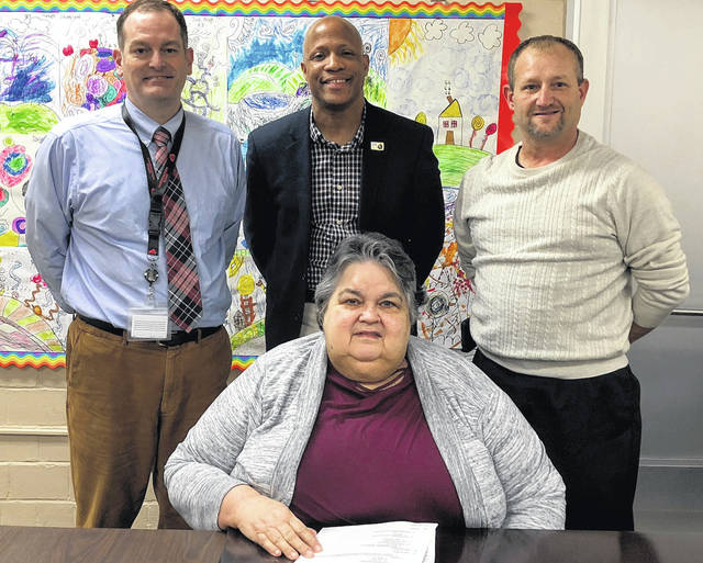 Cardington-Lincoln School Superintendent Brian Petrie with the three members of the Cardington-Lincoln Board of Education whose retirement was honored during the board's December meeting. From left are Petrie, board members Chuck Jones and Troy Ruehrmund and Marilyn Davis, who is seated.