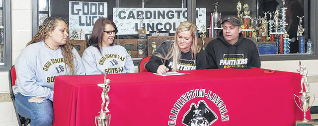 Cardington senior softball player Baylee Adams signs to continue playing in that sport at the next level for Ohio Dominican University. With her are (l-r): sister Alyson, mother Nikki and father Allen.