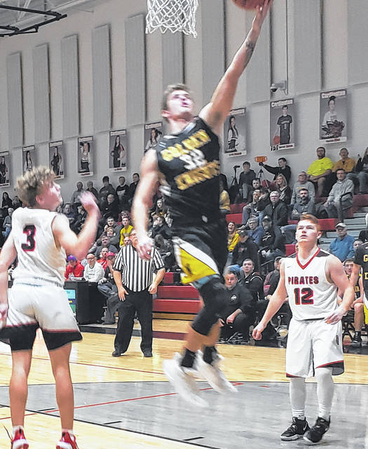 Northmor's Blake Miller works his way inside for two of his game-high 24 points Tuesday night at Cardington.