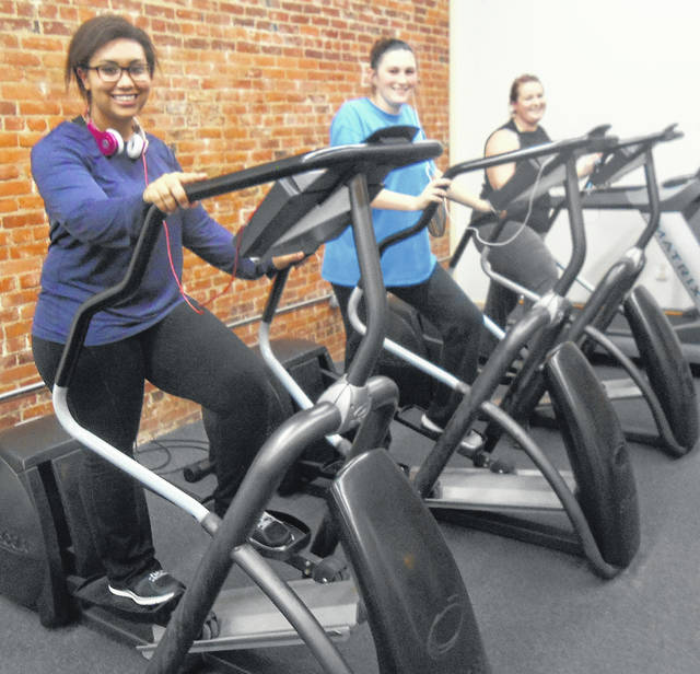 The Community Center Gym on the Square in Mount Gilead will offer a 90-day Fitness Challenge for the fourth year. Here Community Center members enjoy the ellipticals at the open house last year.