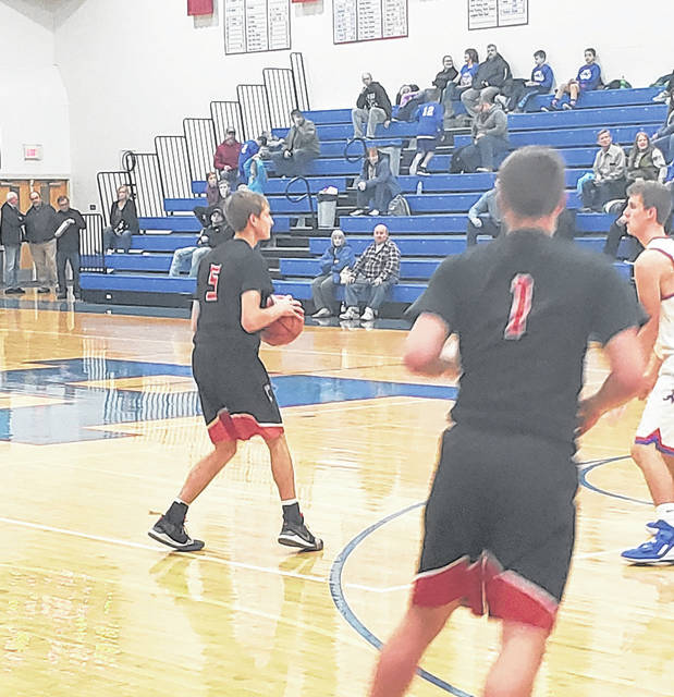Cardington's Garrett Linkous prepares to pass the ball in his team's 66-33 win over Highland Tuesday night.