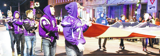 Young men carry the American flag during the recent Christmas parade in downtown Mount Gilead