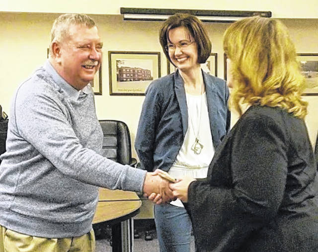 Sentinel Photo Mount Gilead School Board members Virgil Staley and Brandie Salisbury receive congratulations from Judge Jenifer Murphy Burnaugh at their swearing in Jan. 7.