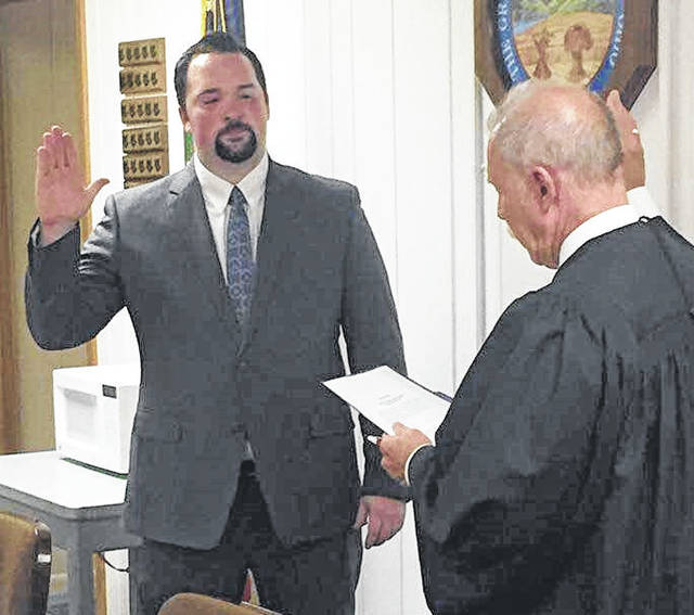 Village officials were sworn in Monday night by Morrow County Common Pleas Court Judge Robert C. Hickson Jr. New Mayor Jamie Brucker and new council member Emily Shaffer, at right, along with incumbents Donna Carver and Chris Sherbourne.