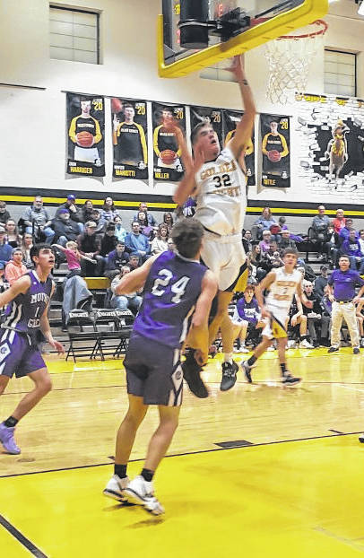 Northmor's Blake Miller goes up for two of his team-high 19 points in Tuesday's win over Mount Gilead.
