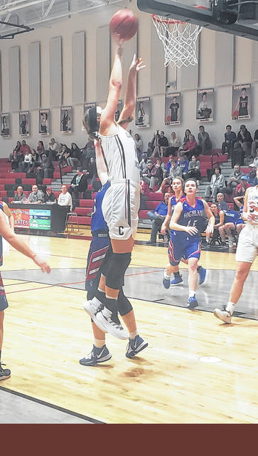Casey Bertke goes up for two of her team-high 19 points in Saturday night's thrilling win over Highland.