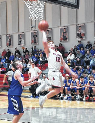 Josh Shook drives to the hoop for two of his game-high 24 points on Friday, as Cardington defeated Danville in boys' basketball.